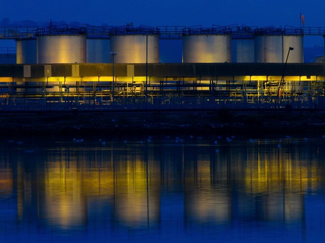 A twilight view of the oil storage tanks on Airport Road seen in J3676 : Oil Storage Tanks, Belfast. See also Link for some related images.   © Copyright Rossographer and licensed for reuse under this Creative Commons Licence